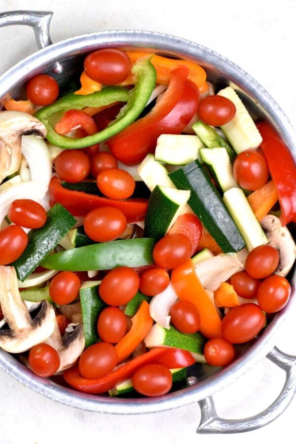 Cut up veggies in a colander.