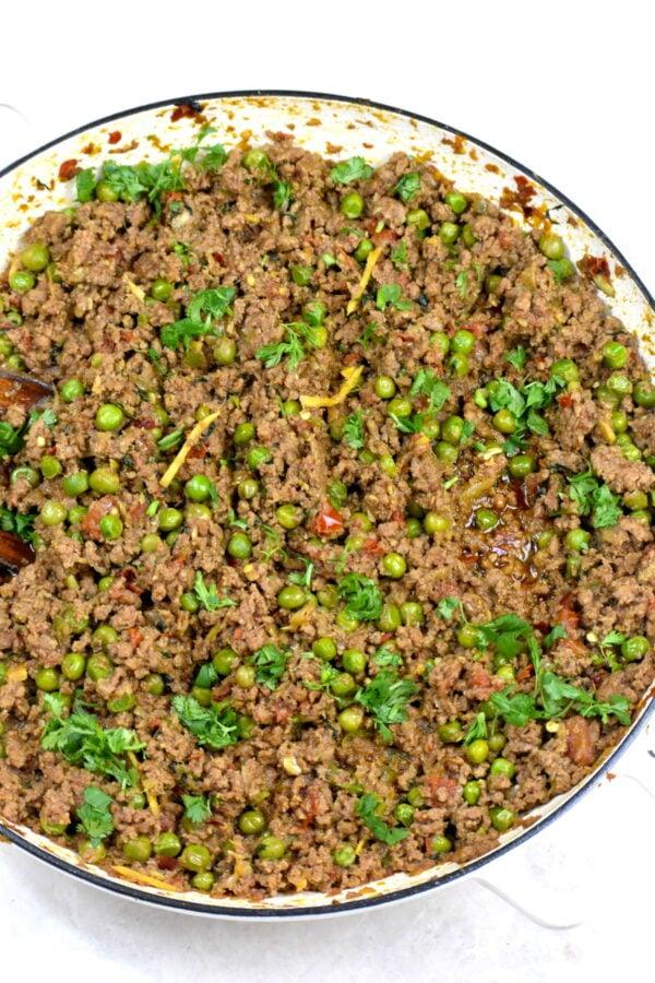 Beef kheema cooking in a pan.