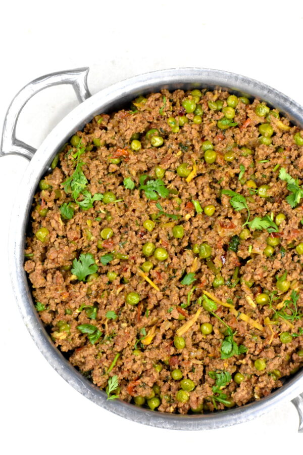 Beef kheema in a metal bowl.