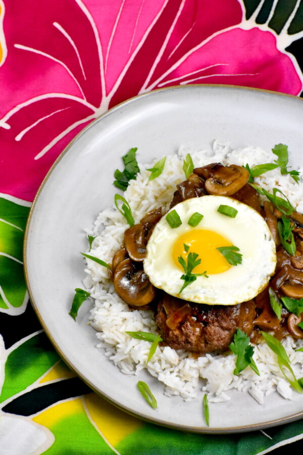 The plate of loco moco atop a colorful sarong.