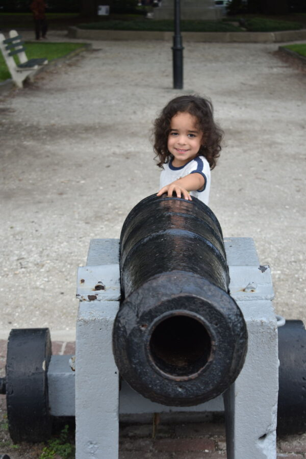 Our son, Noah, by a cannon at the battery.