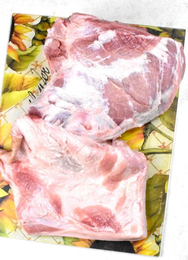 Pork shoulder with the skin pulled back.