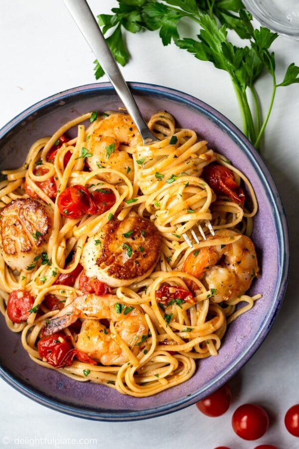 The 25 BEST Scallop Recipes - scallop shrimp pasta with cherry tomatoes.