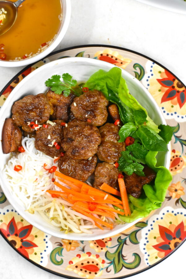 The bowl of bun cha atop the Gypsy Plate.