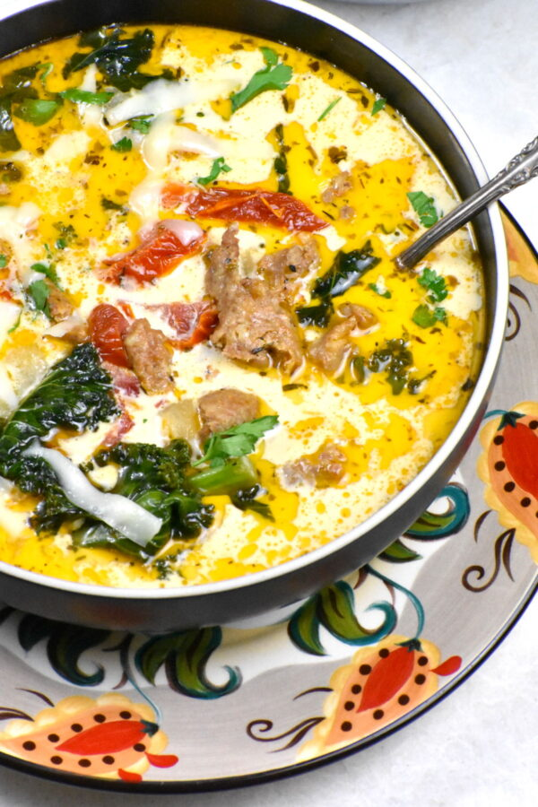 The bowl of creamy Tuscan soup atop the Gypsy Plate.